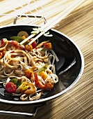 Noodles and vegetables cooked in wok