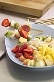 Putting fruit on skewers