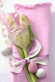 Sweet Easter eggs on a fabric napkin with tulip