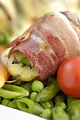 Potatoes and bacon-wrapped figs with vegetables