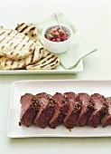 Beef fillet with spice crust, flatbread & tomato salsa