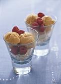 Vanilla and mango ice cream with raspberries