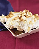 Plum compote with meringue topping