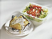 Baked potato with sour cream & mixed salad with tomato