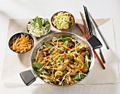 Strips of turkey and vegetables cooked in wok