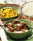 Spicy lamb curry & sweet & sour vegetables with turmeric