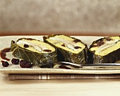 Trout and polenta roll in vine leaves