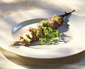 Skewered rose petals and lady's mantle