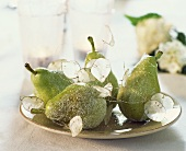 Pears on a plate with 'silver pennies'