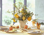 Laid table with vase of spring flowers