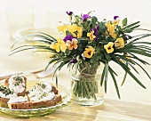 Cress and bread beside posy of horned violets