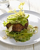 Fried Camembert on green tomato salad