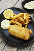 Deep-fried haddock in beer batter with chips and remoulade