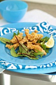 Deep-fried strips of sole with salad leaves