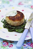 Fish cake on spinach