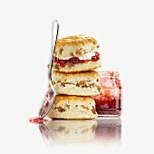 Fruit scones with jam, in a pile