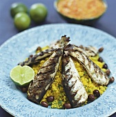 Grilled herrings on couscous salad with olives