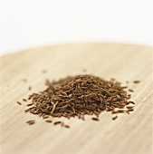 Caraway seed on a wooden platter