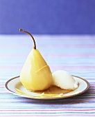Poached pear with a scoop of ice cream