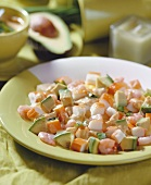Avocado salad with shrimps and surimi