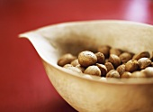 Unshelled almonds in a wooden bowl