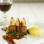 Medallions of elk fillet with fried onions and mashed potato