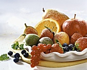 Bowl of fruit with icing sugar