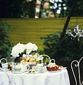 Table laid for coffee in garden