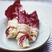 Shellfish wrapped in radicchio and bacon