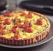 Sweetcorn and spring onion tart with cocktail tomatoes