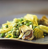 Pan-cooked vegetables: artichokes, peas and beans