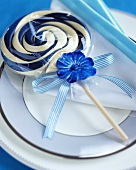 Blue and white pinwheel lollipop on a plate