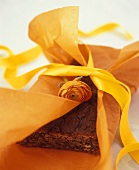 Banana cake with paper and ribbon