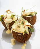 Thai chicken soup in coconut shell