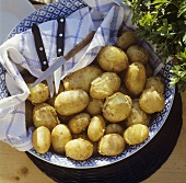 Potatoes cooked in their skins in a bowl