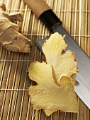 Slices of ginger with knife