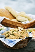 Focaccia with dill and spinach rolls in basket