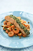 Grilled salmon steak with sesame crust and carrot salad