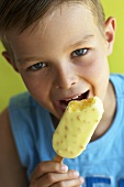 Boy eating an ice cream lolly