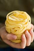 Pasta nest in child's hand