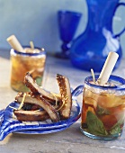 Pork ribs and fruit cocktail with ice