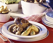 Knuckle of pork, meatballs and potatoes