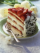 A piece of strawberry cream gateau