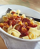 Ribbon pasta with pepper and sausage sauce
