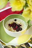Porridge with dried fruit in small bowl
