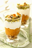 Layered dessert with nuts, apricots and yoghurt