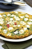 Potato and spinach tortilla with goat's cheese