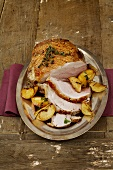Roast pork with crackling and braised apples