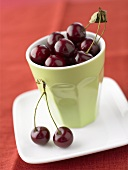 Cherries in a pottery beaker