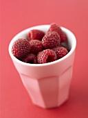 Fresh raspberries in a pottery beaker